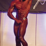Muscular Bodybuilder Flexing In Competition