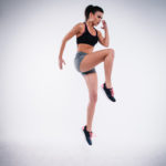 Athletic Woman Doing Plyometrics High Knees Exercise