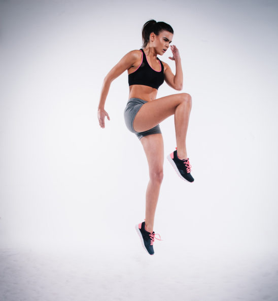 Athletic Woman Doing Plyometrics High Knees Exercise