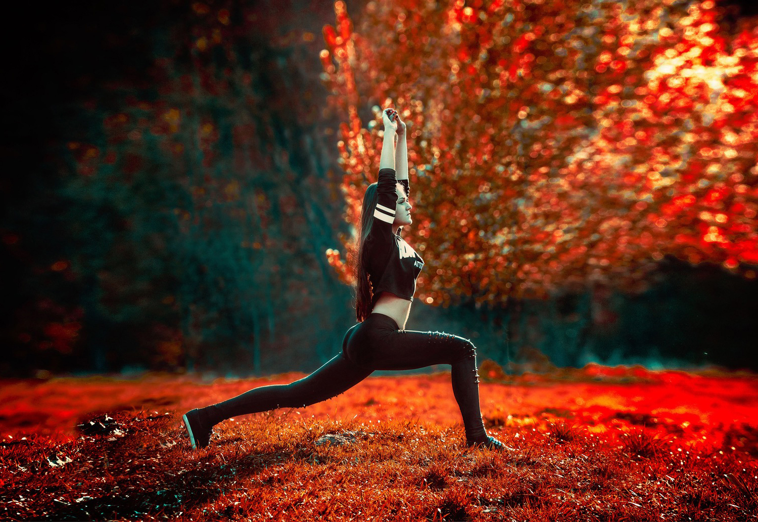 Fit Woman Doing Warrior Yoga Pose Outdoors