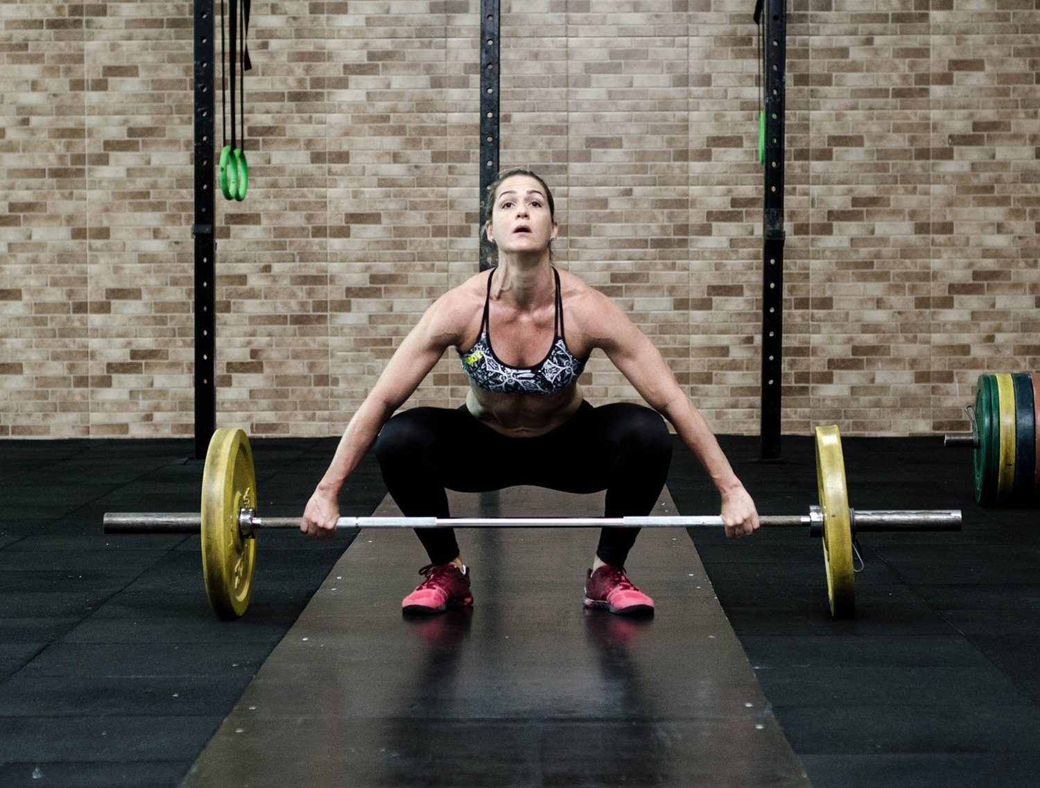Strong Woman Lifting Heavy Weights