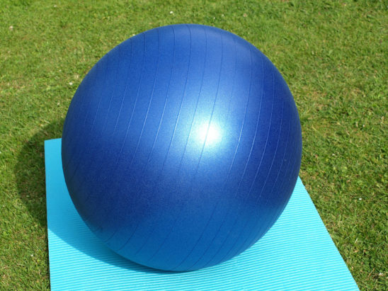 Swiss Ball Placed on Yoga Mat Outdoors
