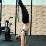 Fit Woman Doing Handstand Exercise