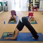 Three Fit Women Practicing Yoga