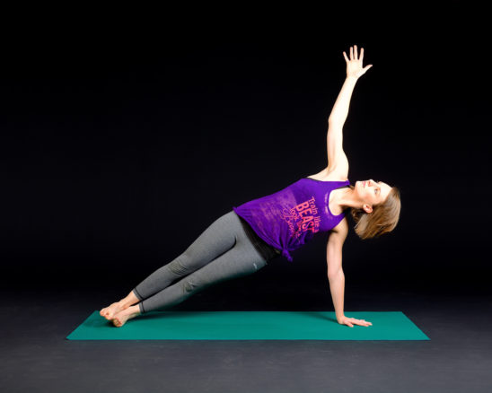 Fitness Woman Doing Side Plank on Yoga Mat