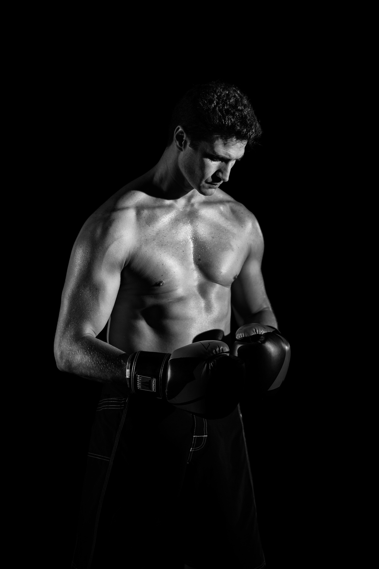 Young Boxer Fighter Wearing Boxing Gloves