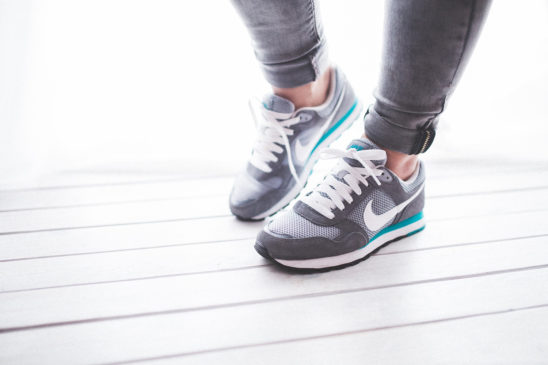 Woman Wearing Sports Shoes Ready To Exercise