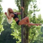 Female Dancer Exercising on Pole