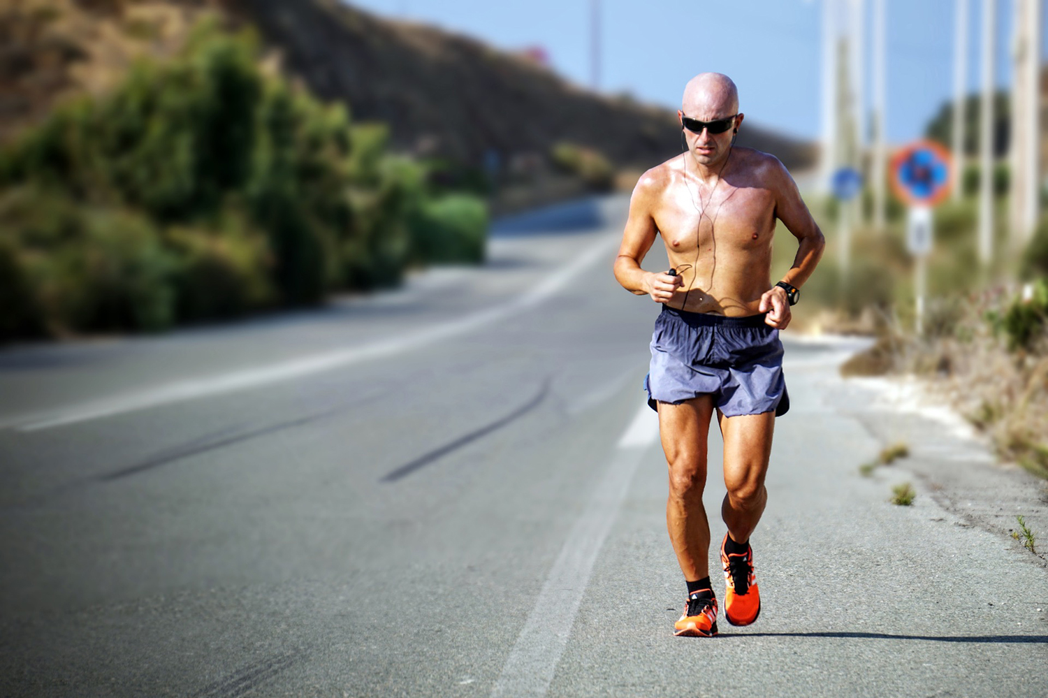 Shirtless Man Running On The Road on A Sunny Day