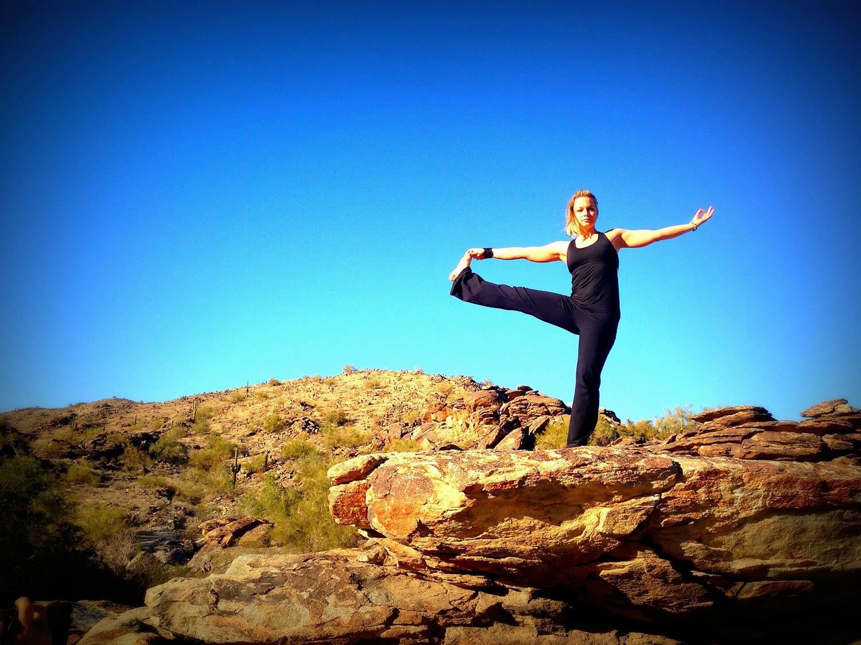 Woman Doing Balancing Yoga Pose. Extended Hand To Big Toe Yoga Pose