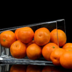 Oranges In A Glass on Black Background