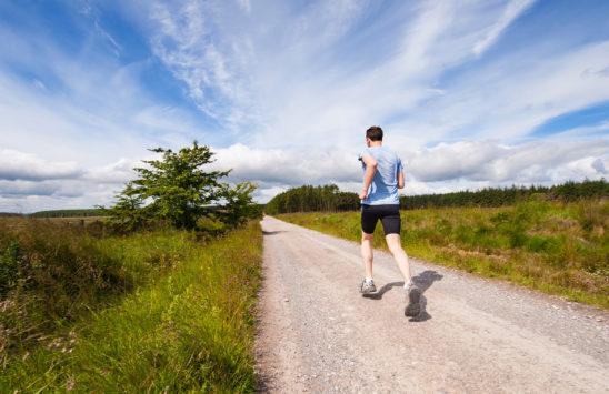 Runner Jogging On Rough Road