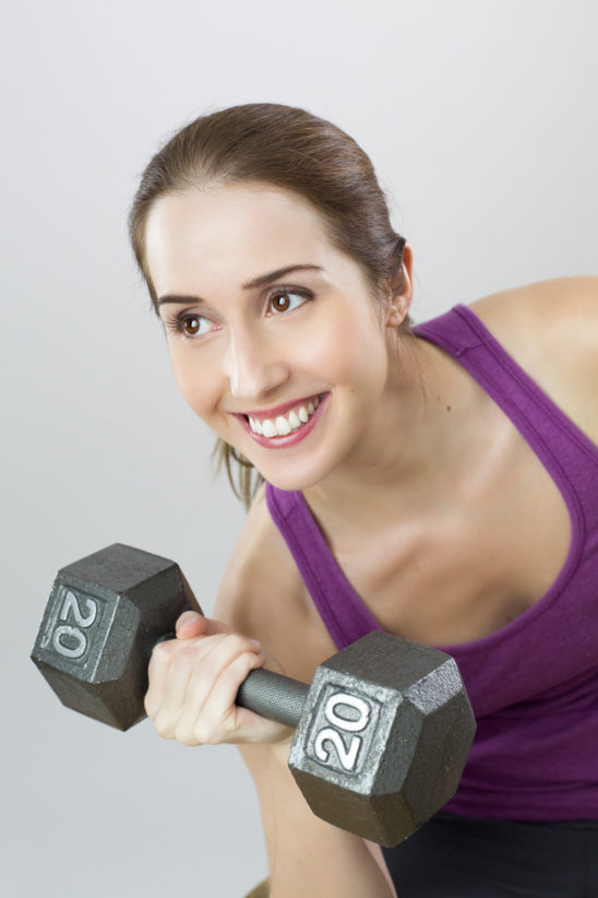 Fit Woman Lifting A Dumbbell