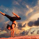 Strong Woman Doing Balancing Yoga Pose Outdoors