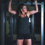 Strong Woman Doing Pull Ups Exercise
