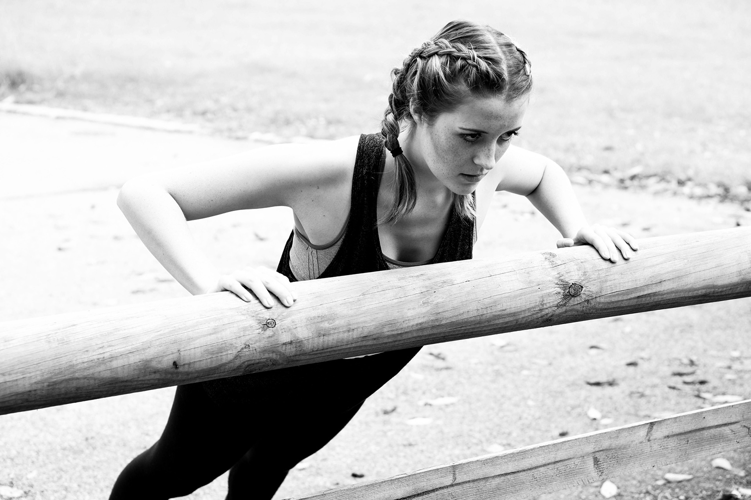 Young Woman Doing Incline Push Ups Variation