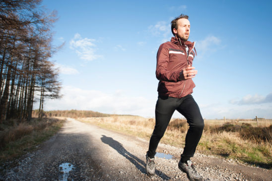 Jogger Running on Sunny Day