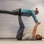 Couple Practicing Acro Yoga