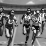 Female Athletes Sprinting In Relay Race Competition
