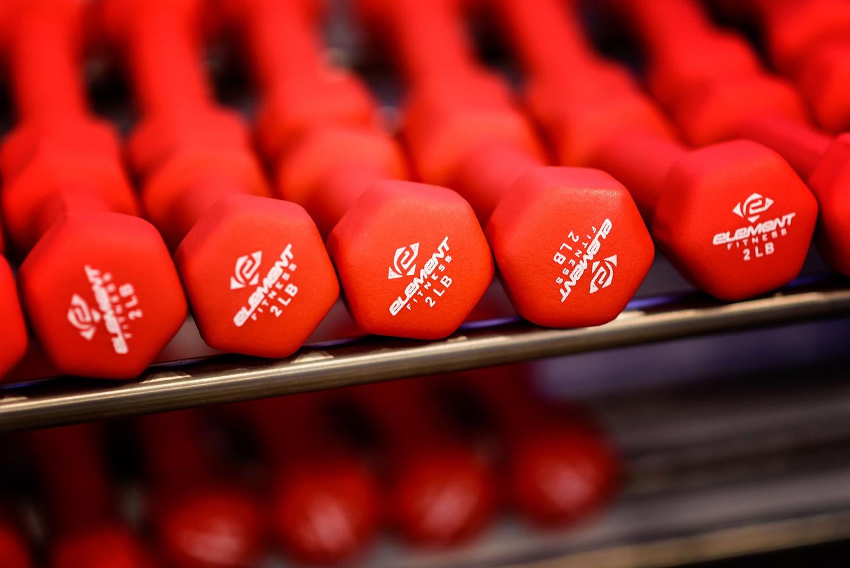 Red Dumbbells On Rack