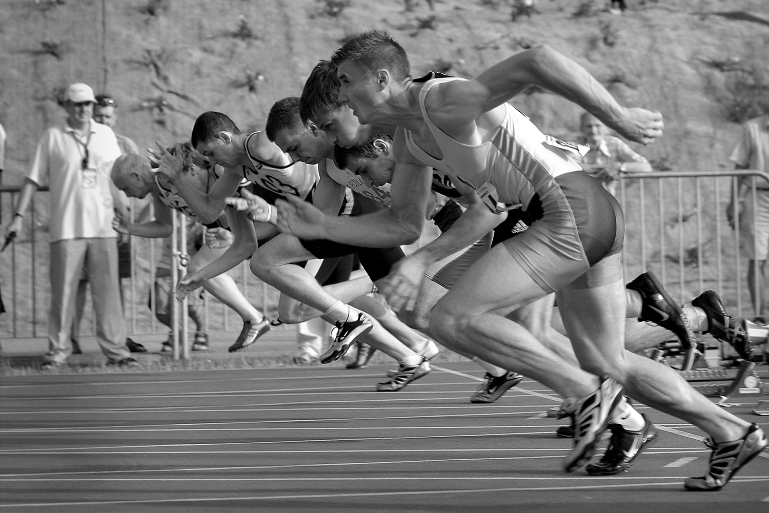 Athletes Starting A Running Competition In The Field Track