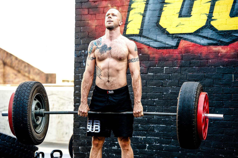 Strong Man Doing Deadlift Exercise