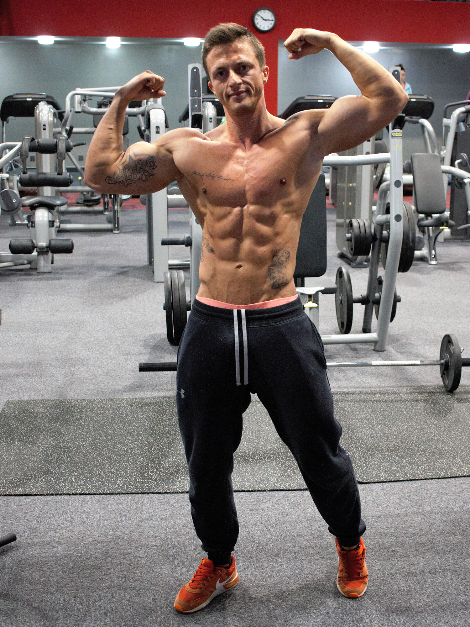 Muscular Man Flexing At The Gym