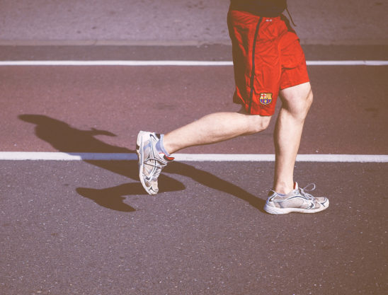 Legs of Man Running On The Track