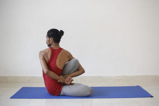 Flexible Man Practicing Yoga
