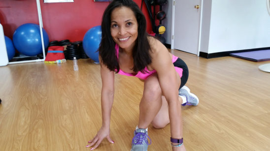 Smiling Woman Exercising in The Gym