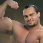 Male Bodybuilder Flexing Biceps Muscles