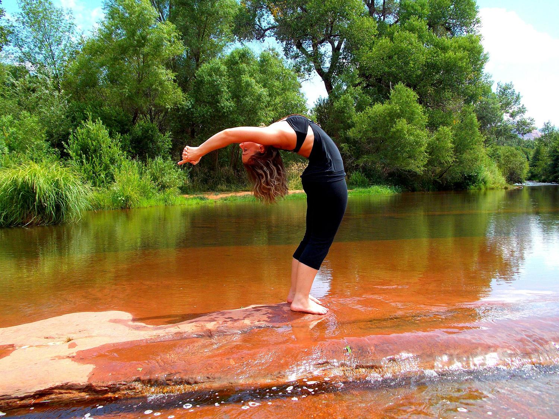 Flexible Woman Doing Backbend Yoga Pose Outdoors