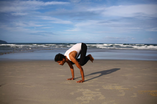 Fit Man Doing Crow Pose. Yoga Pose To Improve Your Handstand
