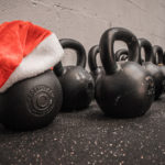 Kettlebells and Father Christmas Hat. Holiday Workout Concept