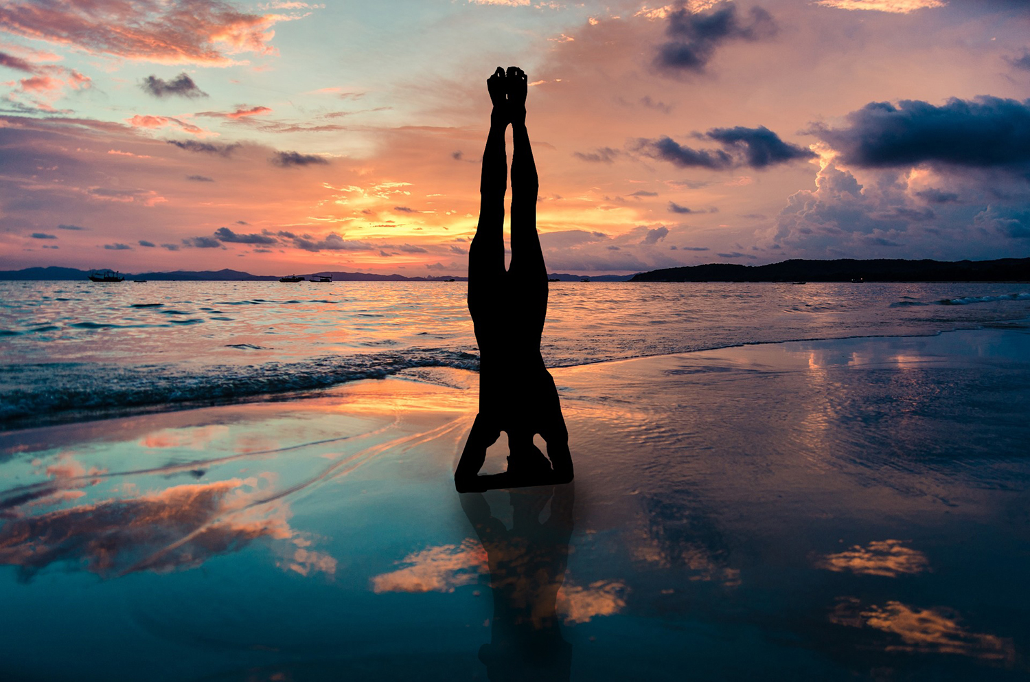 Silhouette Of Woman Doing Headstand Yoga Pose In The Beach
