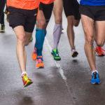 Muscular Legs of Runners in A Marathon Race