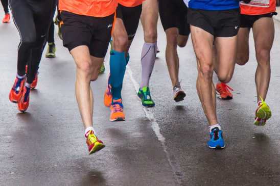 Muscular Legs of Runners in A Marathon Race