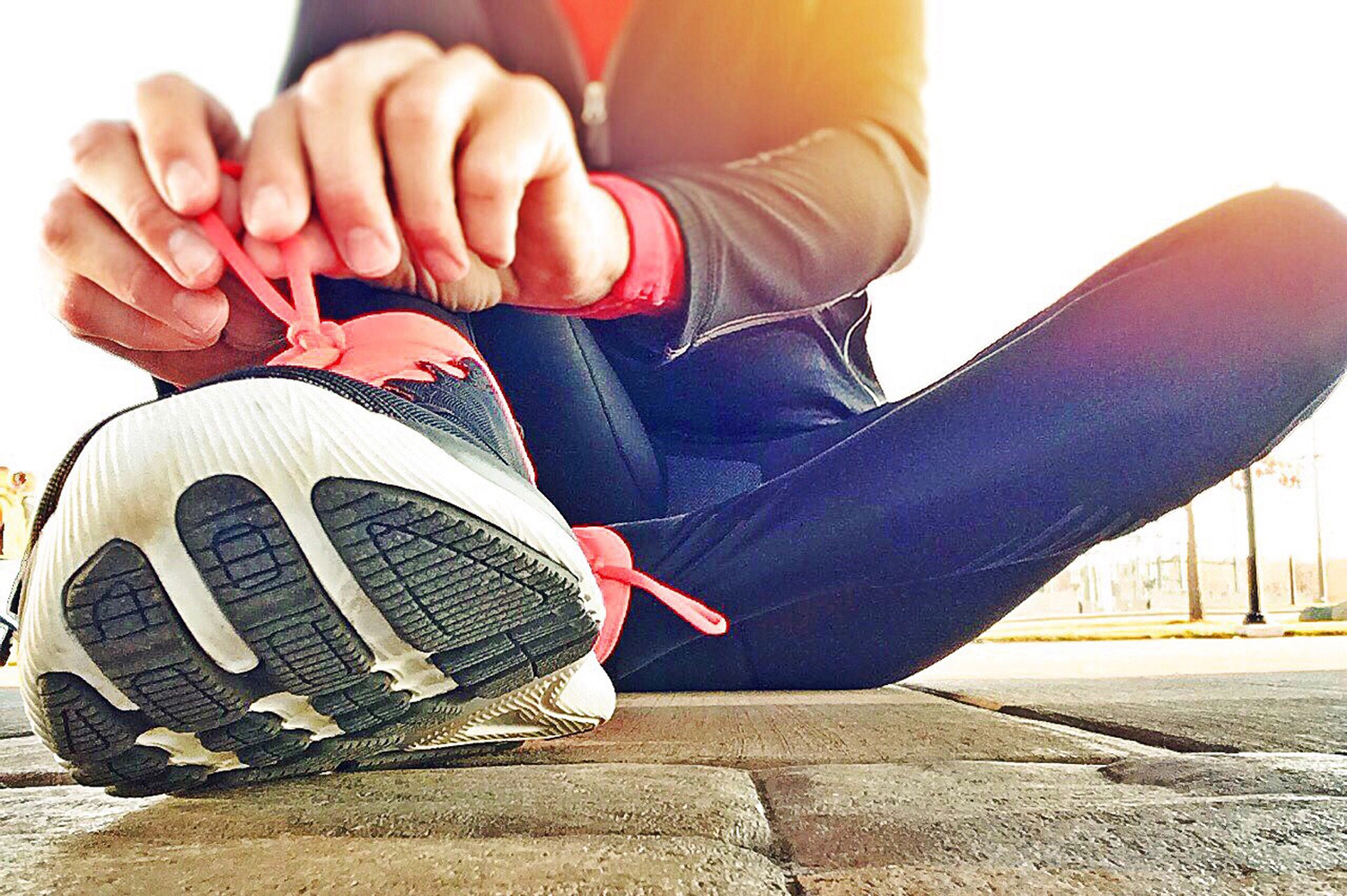 Fit Runner Tying Shoes Ready to Jog