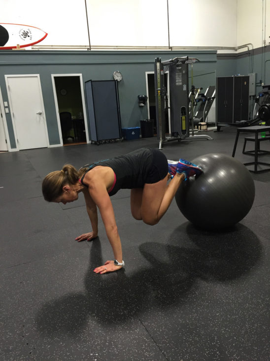 Woman Doing Ab Exercise With Swiss Ball In The Gym
