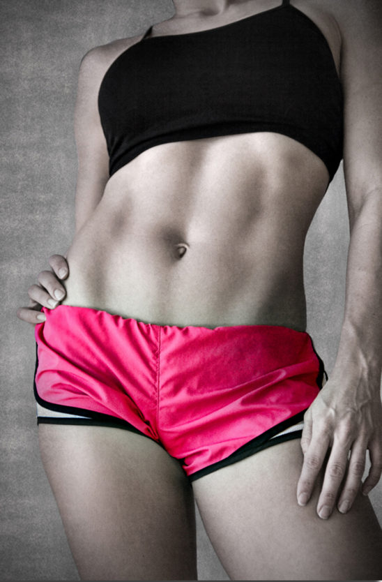 Close-up Fit Woman With Abs. Abdominal Muscles