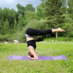 Strong Woman Doing Supported Headstand Yoga Pose Outdoors