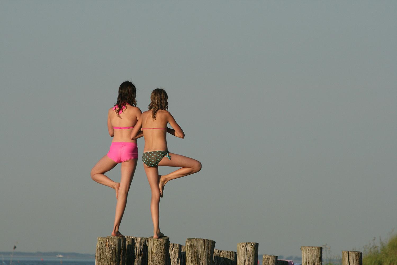 Two Women Doing Balancing Yoga Pose