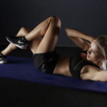 Toned Woman Doing Bicycles Ab Exercise