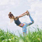 Flexible Woman Doing Dancer's Pose Outdoors