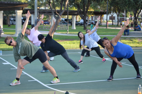 Fitness Group Practicing Yoga Outdoors
