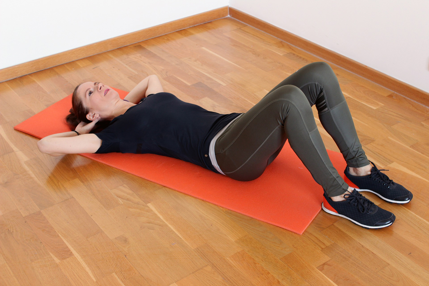 Fit Woman Doing Crunches on Yoga Mat