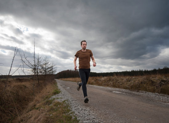 Fit Man Jogging on Cloudy Day