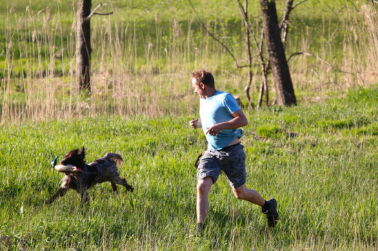 Man Exercising With With Dog