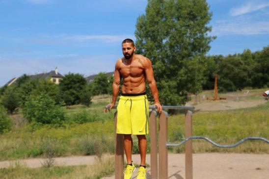 Muscular Man Doing Triceps Dips Bodyweight Exercise
