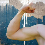 Muscular Man Flexing Biceps